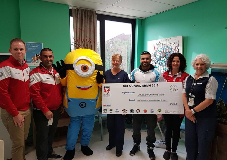 Presenting a cheque to St George Hospital
