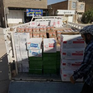 Distribution of 300 baskets of aid to war displaced orphans and families in Najaf, Iraq.